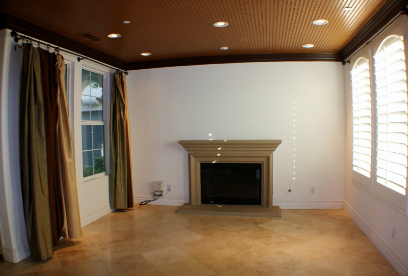 Living Room with Fireplace & Travertine Floors
