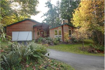 This home is located on a peaceful, nature filled lot of .76 acres.