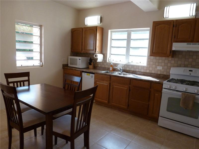 Full-Sized Kitchen with Dining Area in Apartment