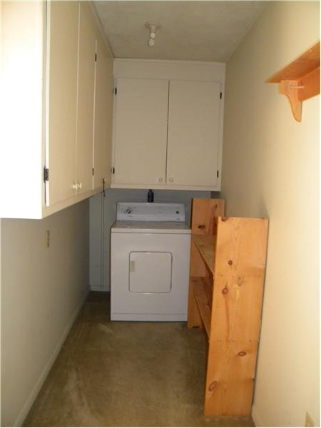 Spacious Inside Laundry  & Storage Area