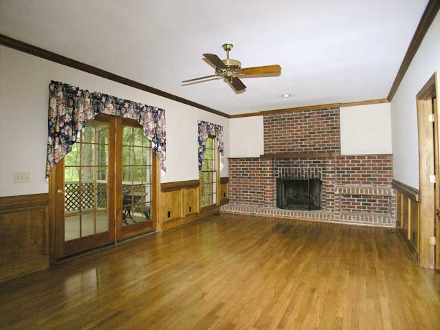 Great room with fireplace and access to screen porch