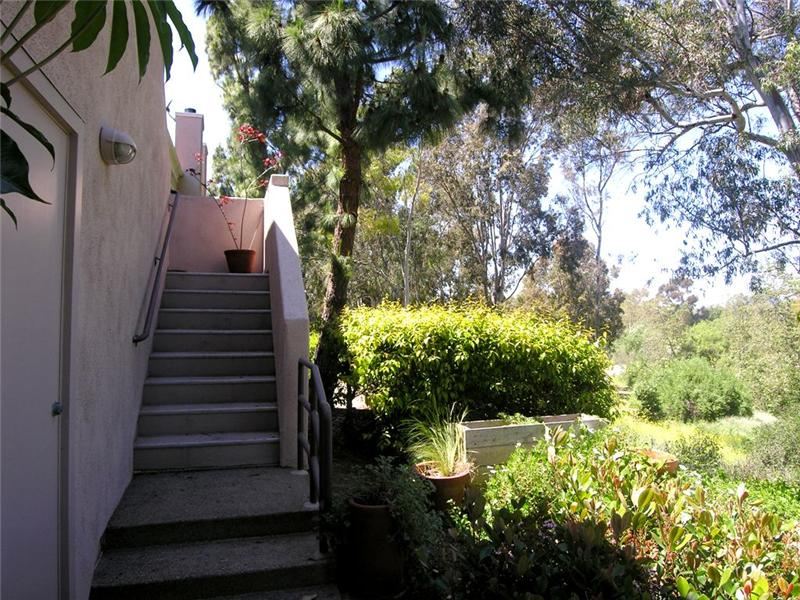 Private stairway leads up to the entry of 33 Auburn Aisle adjacent to Mason Park