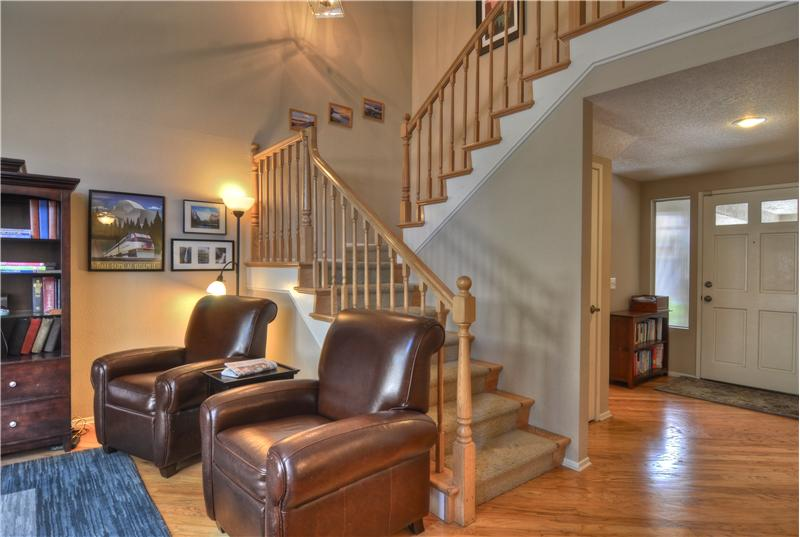 Ascend the Dramatic Custom Wood Staircase & Banister to the Upstairs Bedrooms