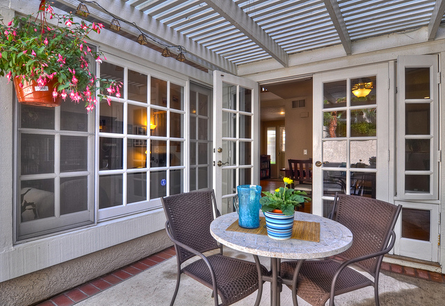 French Doors Open Out to a Serene Backyard Patio