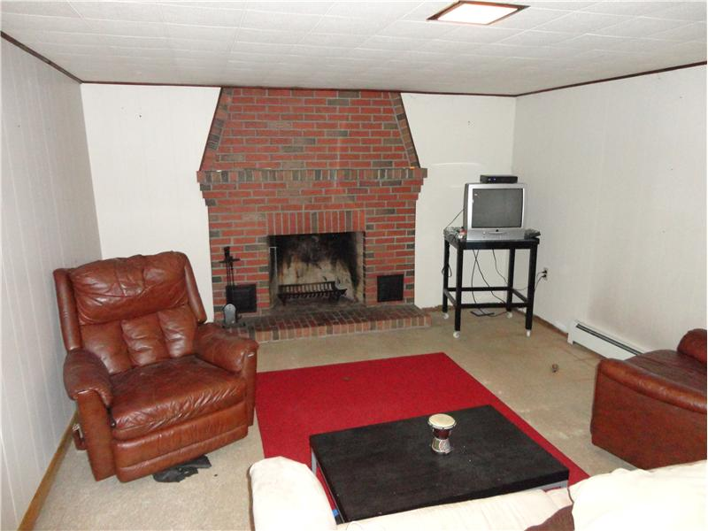 Lower Level Den/Family Room - Large 26x13 and features a fireplace!!!