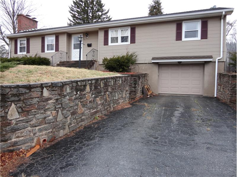 Front - Beautiful stone work and garage!