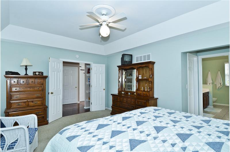 Master w/coffered ceiling ,fan & walk-in closet.