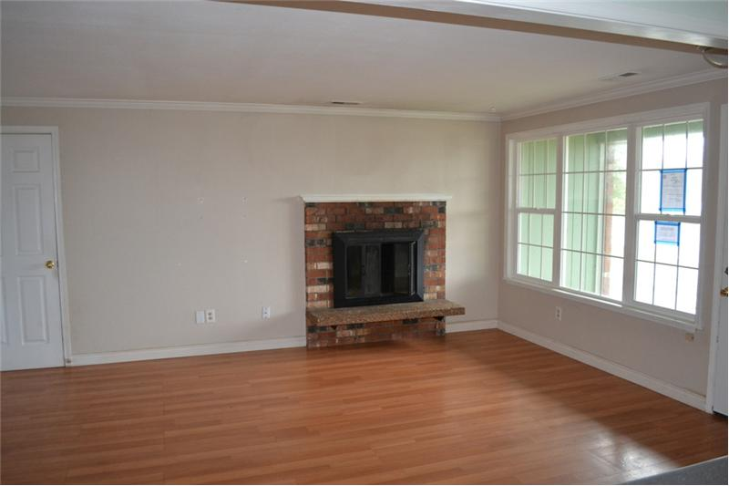 Brick fireplace in large living room