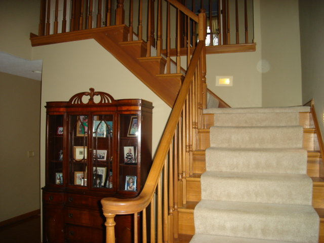 Two story foyer with hardwood floors