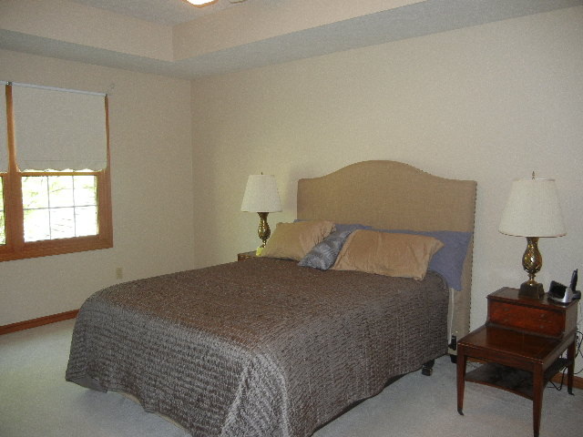 Relax in this lovely master suite, Two large walk in closets lead to a walk in storage area above the garage.