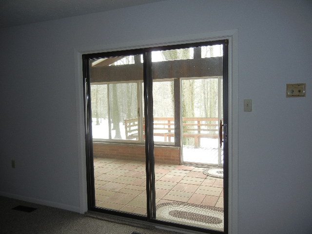 Sliding doors in the family room lead to an enclosed patio and deck.
