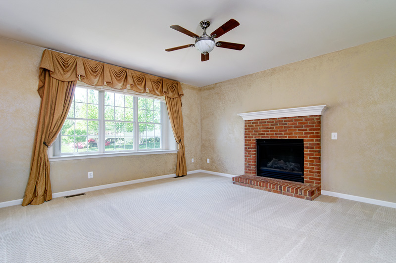 Alternate view of family room w/fireplace