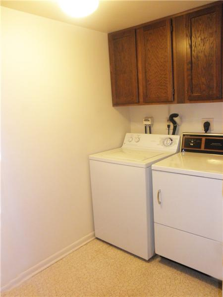 Utility Room with Full Size Washer and Dryer