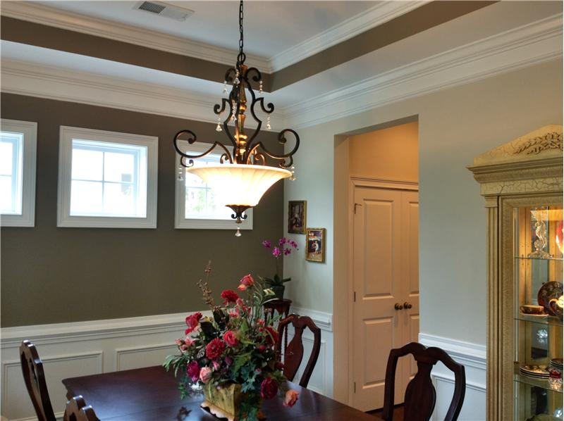 Heavy crown molding throughout dining room