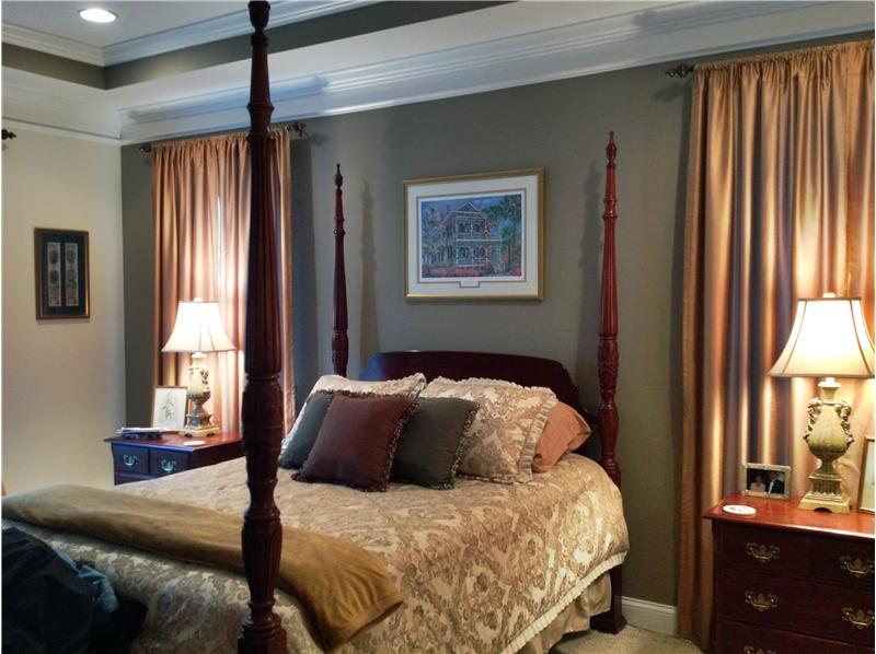Master bedroom with tray ceiling & moulding