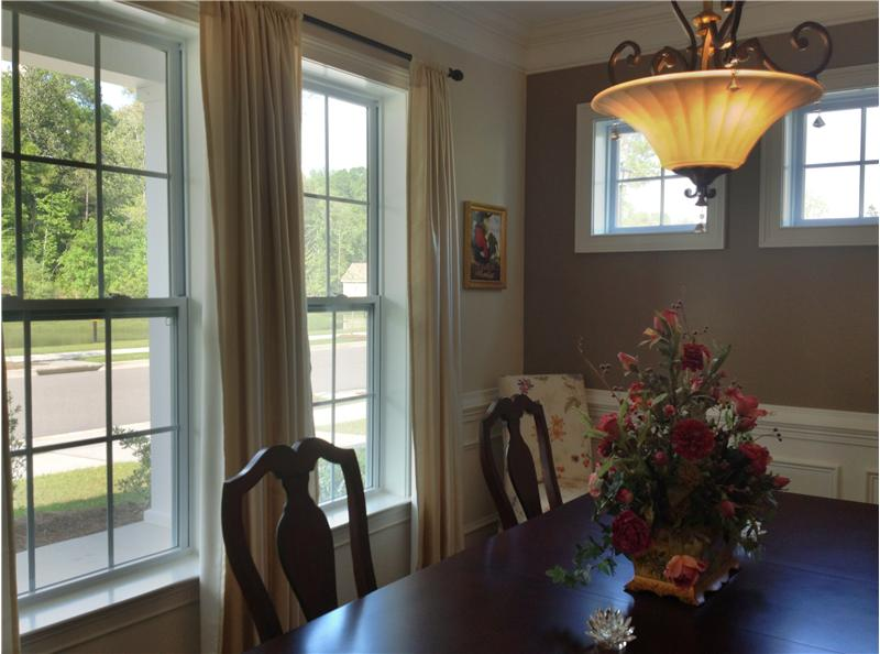 Formal dining room overlooks pond