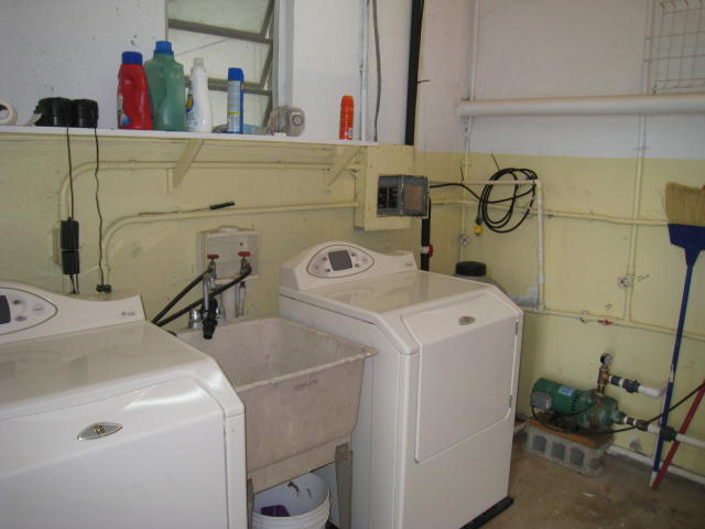 Laundry Room with Maytag Neptune Appliances