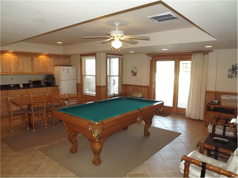 7 foot pool table leads to the outdoor pool!