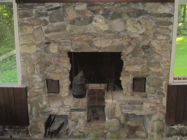 Fireplace on lower level of screened-in porch