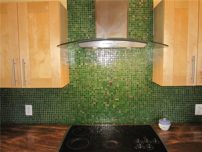 Tile backsplash and curved hood