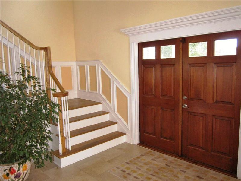 Wood front doors and staircase to upper level