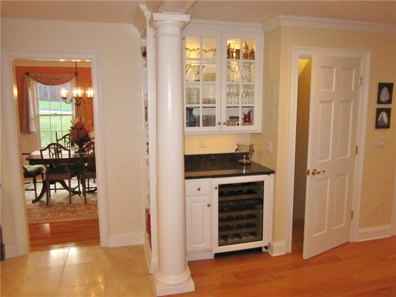 Built-in cabinets and wine refrigerator in breakfast room