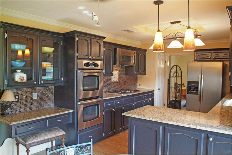Gorgeous cabinets, exotic granite, updated lighting