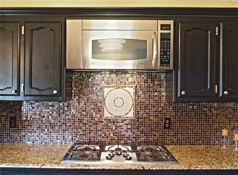 Gorgeous glass tile backsplash