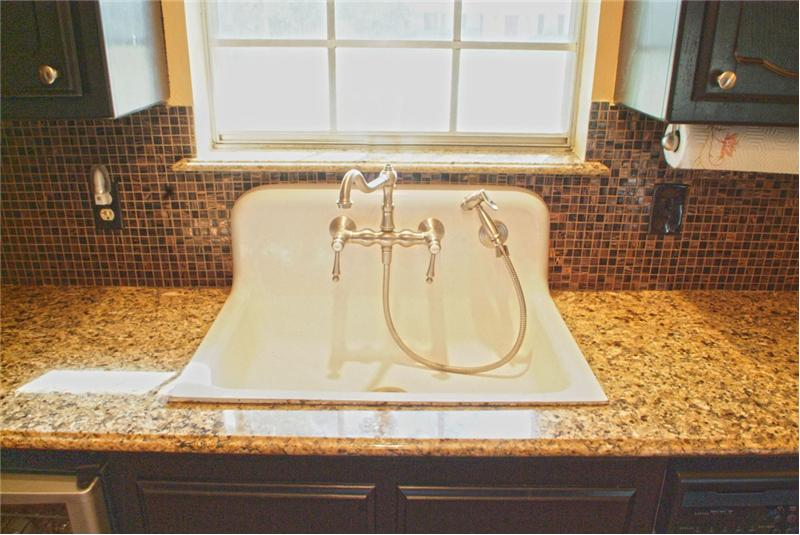 Antique 1909 sink and granite on the window sills!