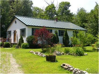 Updated cape on 2.0 acres has a brand new standing seam metal roof